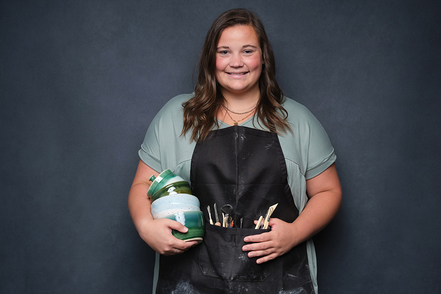 Abbie with ceramics and working apron